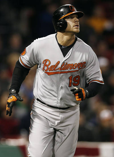 Baltimore Orioles' Chris Davis watches his solo home run against the Boston Red Sox during the second inning of a baseball game at Fenway Park in Boston, Thursday, April 11, 2013. (AP Photo/Winslow Townson)