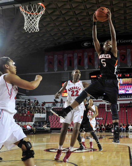 Mercer forward Sharmesia Smith (5) grabs a rebound against Georgia during the second half of an NCAA college basketball game, Tuesday, Dec. 4, 2012, in Athens, Ga. Georgia won 80-38. (AP Photo/Richard Hamm)