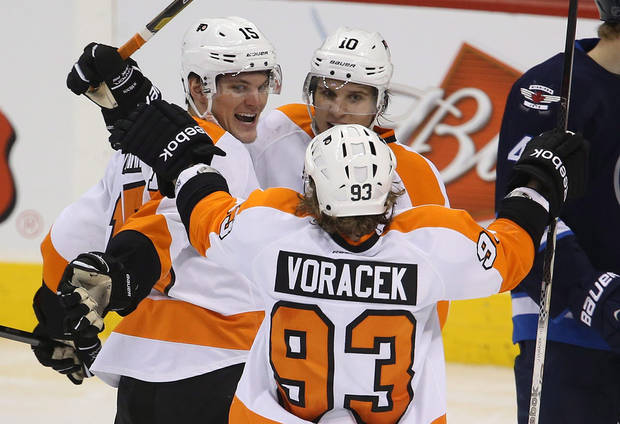 Philadelphia Flyers' Tye McGinn (15) celebrates his goal against the Winnipeg Jets with teammates Brayden Schenn (10) and Jakub Voracek (93) during the third period of an NHL hockey game in Winnipeg, Manitoba, Tuesday, Feb. 12, 2013. (AP Photo/The Canadian Press, Trevor Hagan)