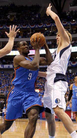 Oklahoma City's Serge Ibaka (9) tries to get past Dirk Nowitzki (41) of Dallas  during game 1 of the Western Conference Finals in the NBA basketball playoffs between the Dallas Mavericks and the Oklahoma City Thunder at American Airlines Center in Dallas, Tuesday, May 17, 2011. Photo by Bryan Terry, The Oklahoman