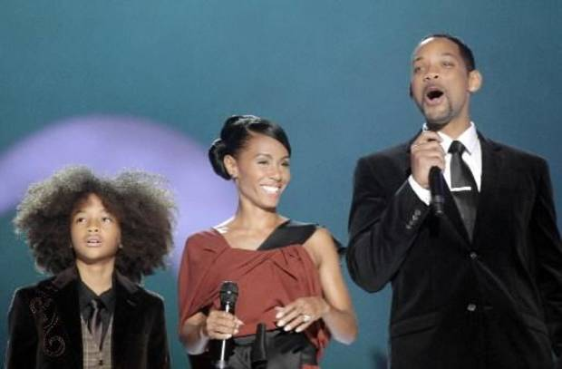 Jaden Smith, left, appeared on stage with his parents Jada Pinkett Smith and Will Smith during the Nobel Peace concert. (AP Photo/John McConnico)