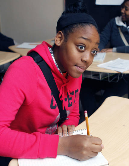 Dasheri Adams studies Thursday at Douglass High School. Photo by Paul Hellstern, The Oklahoman <strong>PAUL HELLSTERN</strong>