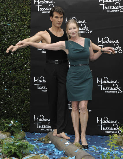In this handout photo courtesy of Madame Tussauds Hollywood, Lisa Swayze unveils a wax figure of her late husband actor Patrick Swayze at Madame Tussauds Hollywood in Los Angeles on Tuesday, Oct. 18, 2011.(AP Photo/Madame Tussauds, Dan Steinberg)