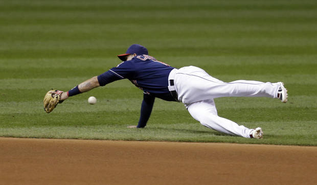 Cleveland Indians shortstop Asdrubal Cabrera dives for a single hit by Baltimore Orioles shortstop J.J. Hardy in the fifth inning of a baseball game, Tuesday, Sept. 3, 2013, in Cleveland. (AP Photo/Tony Dejak)