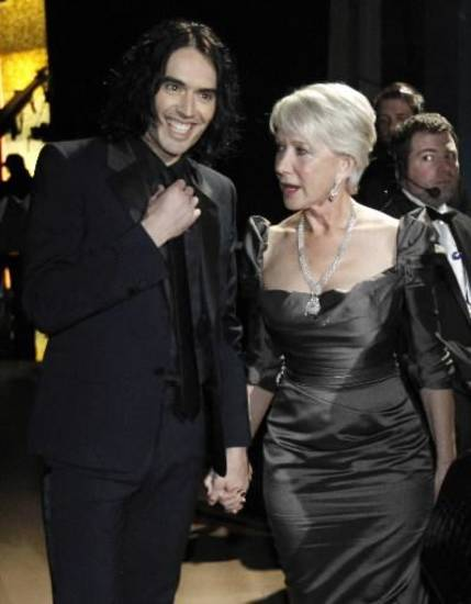 Presenters Russell Brand and Helen Mirren chat backstage.