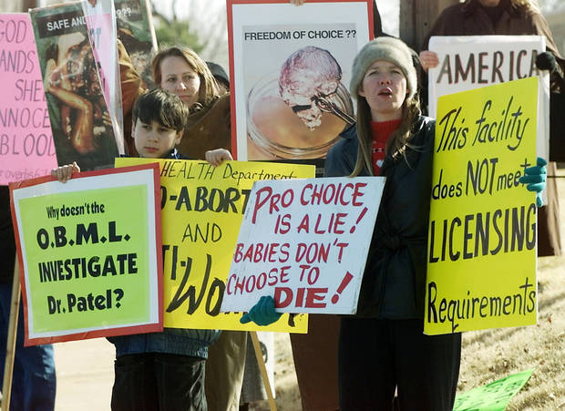 ABORTION PROTEST: Sharon Golmoradi & her son Kia Golmoradi protest with Anna Voellmecke outside a NW OKC clinic.