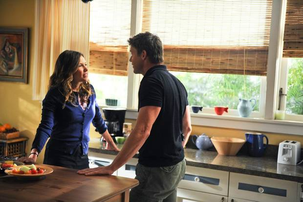"Kiele Sanchez and Matt Passmore star in ""The Glades."" - Photo credit: ©2013 A+E Networks / Photo credit: Jeff Daley"