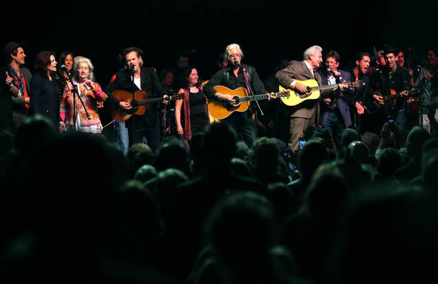 All the peformers of the Woody Guthrie Centennial Concert including Taylor Hanson, Rosanne Cash, Nora Guthrie, John Mellencamp, Arlo Guthrie, Del McCoury, Tim O&#039;Brien and Hanson perform &quot;This Land is Your Land&quot; at the Brady Theater Saturday March 10, 2012.  (AP Photo/Christopher Smith, Tulsa World) ORG XMIT: OKTUL111