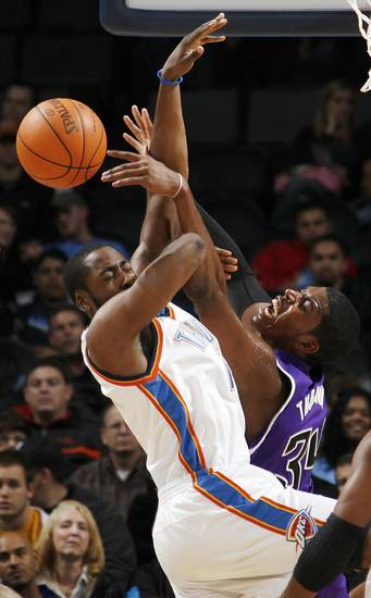 Sacramento's Jason Thompson (34), right, collides with James Harden (13), left, of Oklahoma City during the NBA preseason game between the Sacramento Kings and the Oklahoma City Thunder at the Ford Center in Oklahoma City, Thursday, Oct. 22, 2009. Photo by Nate Billings, The Oklahoman