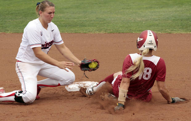 OU / COLLEGE SOFTBALL / NCAA SUPER REGIONAL: Oklahoma's Jessica Shults is safe at second beating a tag by Shelby Pendley as the University of Oklahoma Sooner softball team plays Arizona in game two of the NCAA Softball Norman Super Regional at Marita Hynes Field on Saturday, May 26, 2012, in Norman, Okla.  Head coach Patty Gasso approached the umpire and argued for a safe runner.  Photo by Steve Sisney, The Oklahoman
