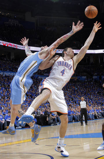 Denver's Chris Andersen (11) and Oklahoma City's Nick Collison (4) battle for a rebound during the first round NBA playoff game between the Oklahoma City Thunder and the Denver Nuggets on Sunday, April 17, 2011, in Oklahoma City, Okla. Photo by Chris Landsberger, The Oklahoman