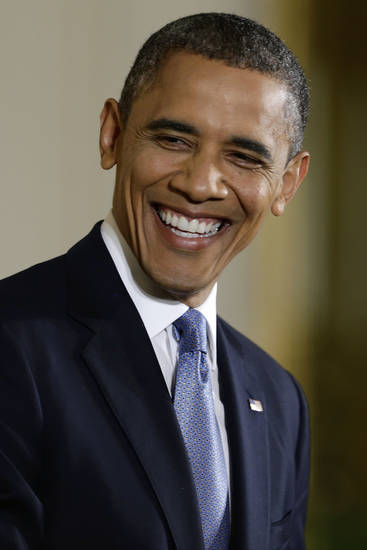President Barack Obama smiles at a question during a news conference in the East Room of the White House in Washington, Wednesday, Nov. 14, 2012. (AP Photo/Charles Dharapak)