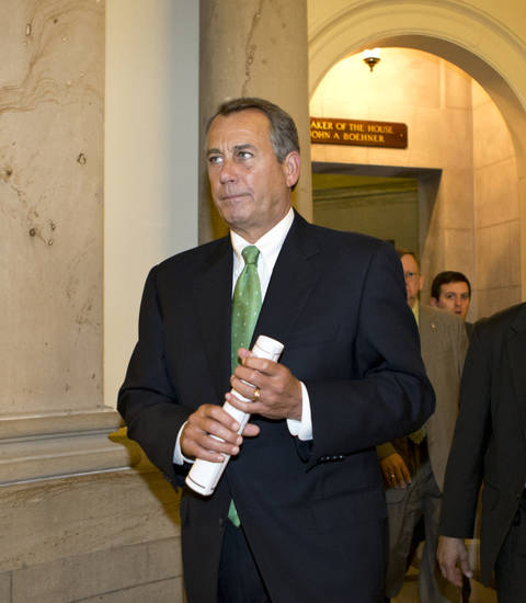 House Speaker John Boehner of Ohio walks to the House floor to deliver remarks about negotiations with President Barack Obama on the fiscal cliff, Tuesday, Dec. 11, 2012, on Capitol Hill in Washington. Boehner said President Barack Obama is slow-walking talks to avoid the fiscal cliff, and hasn't outlined spending cuts he's willing to support as part of a compromise.   (AP Photo/J. Scott Applewhite)