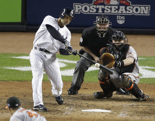   New York Yankees&#039; Raul Ibanez hits a solo home run to tie the game in the ninth inning in Game 3 of the American League division baseball series against the Baltimore Orioles on Wednesday, Oct. 10, 2012, in New York. The Orioles catcher is Matt Wieters and the umpire is Brian Gorman. (AP Photo/Peter Morgan)  