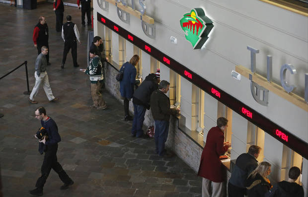 Minnesota Wild NHL hockey fans buy single game tickets Wednesday, Jan. 16, 2013, in St. Paul, Minn. The Wild play their home opener Saturday against the Colorado Avalanche. (AP Photo/Jim Mone)