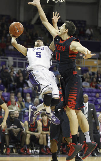 TCU&#039;s Kyan Anderson (5) is blocked by Texas Tech&#039;s Dejan Kravic (11) during an NCAA college basketball game Saturday, Jan. 5, 2013, in Fort Worth, Texas. Texas Tech defeated TCU 62-53. (AP Photo/The Fort Worth Star-Telegram, Joyce Marshall) MAGS OUT; (FORT WORTH WEEKLY, 360 WEST); INTERNET OUT