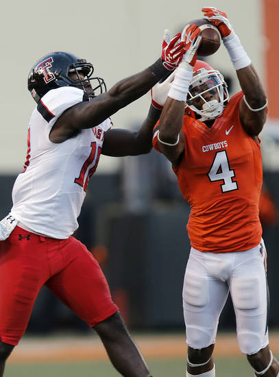 Oklahoma State's Justin Gilbert (4) breaks up a pass to Texas Tech's Eric Ward (18) during the college football game between the Oklahoma State University Cowboys (OSU) and Texas Tech University Red Raiders (TTU) at Boone Pickens Stadium on Saturday, Nov. 17, 2012, in Stillwater, Okla.   Photo by Chris Landsberger, The Oklahoman