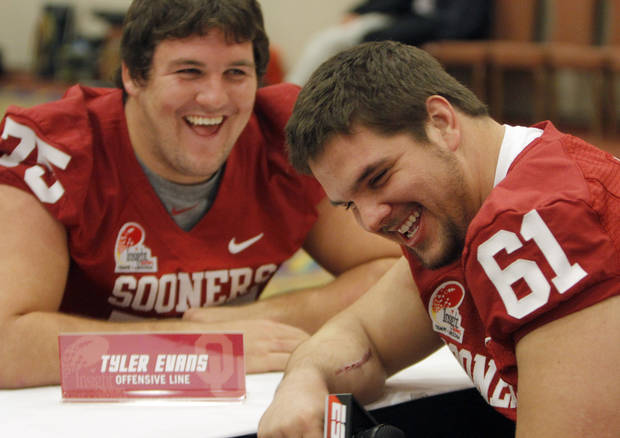 OU / COLLEGE FOOTBALL: Oklahoma&#039;s Tyler Evans (75) and Ben Habern (61) laugh while interviewing each other during a University of Oklahoma media day for the Insight Bowl at the Camelback Inn in Paradise Valley, Ariz.,  Wednesday, Dec. 28, 2011. Photo by Sarah Phipps, The Oklahoman