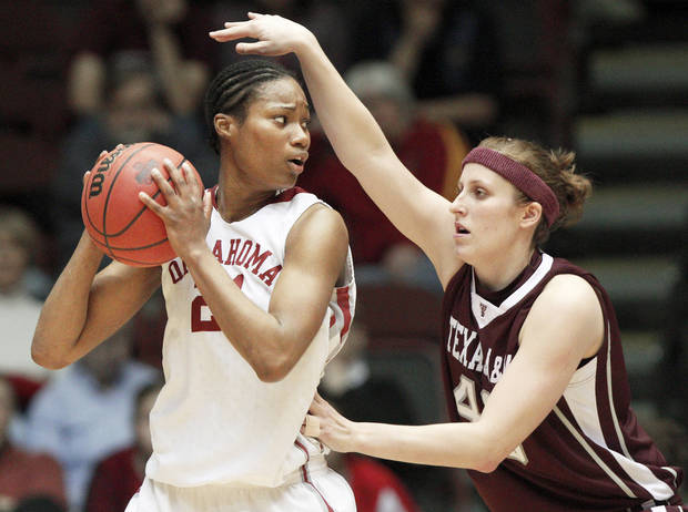 OU's Amanda Thompson is defended by Texas A&M's Kelsey Assarian during the Big 12 women's basketball tournament in Kansas City, Mo., this season. PHOTO BY BRYAN TERRY, THE OKLAHOMAN