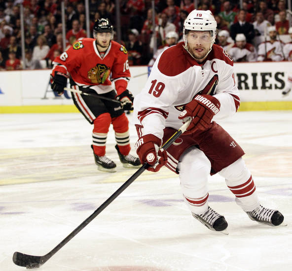 Phoenix Coyotes' Shane Doan (19) controls the puck against the Chicago Blackhawks during the first period of Game 6 of an NHL hockey Stanley Cup first-round playoff series in Chicago, Monday, April 23, 2012. The Coyotes won 4-0. (AP Photo/Nam Y. Huh)