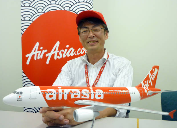 In this Sept. 28, 2012 photo, AirAsia Japan President Kazuyuki Iwakata speaks during an interview in Tokyo. �It�s not that the meals on standard fares were ever free. The charge was just part of the ticket price,� Iwakata told The Associated Press. �With us, people pay only for what they need.� As a marketing ploy, AirAsia Japan, which started operations in August, offered tickets for just 5 yen (5 cents) to the first 10,000 people. They quickly sold out. (AP Photo/Yuri Kageyama)