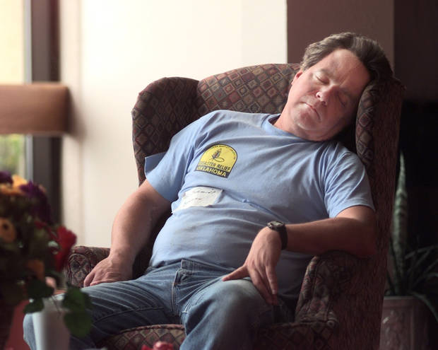 MAY 3, 1999 TORNADO: Ken Schmidt, Duncan volunteer with the Southern Baptist Convention Disaster Relief group dozes at noon wednesday in the lobby of Del City First Southern Baptist Church.  Schmidt left Duncan at 7:00 a.m. tuesday and has had little sleep since while preparing meals for tornado victims.