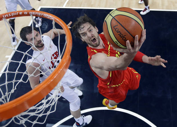 Spain's Pau Gasol, right, drives past United States' Kevin Love, left, to score during the men's gold medal basketball game at the 2012 Summer Olympics, Sunday, Aug. 12, 2012, in London. (AP Photo/Eric Gay, pool)