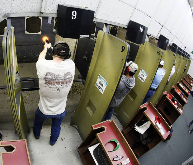Participants fire their handguns on a gun range during a concealed-carry class at H&H Gun Range and Shooting Sports Complex on Wednesday in Oklahoma City. Photo by Nate Billings, The Oklahoman <strong>NATE BILLINGS</strong>