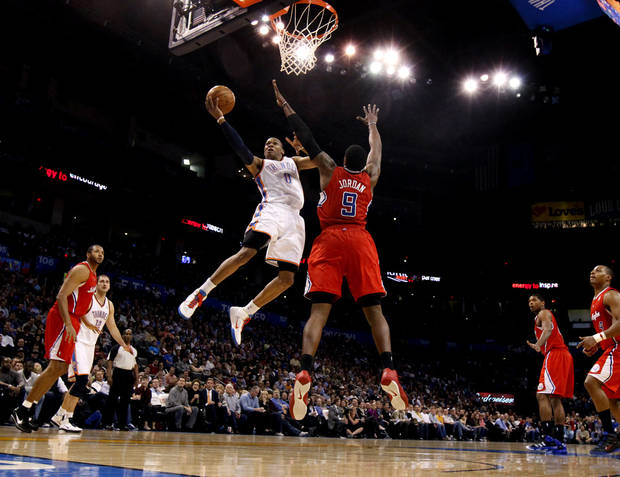 Oklahoma City's Russell Westbrook (0) goes past Los Angeles' DeAndre Jordan (9) during the NBA basketball game between the Oklahoma City Thunder and the Los Angeles Clippers at the Oklahoma CIty Arena, Tuesday, Feb. 22, 2011.  Photo by Bryan Terry, The Oklahoman