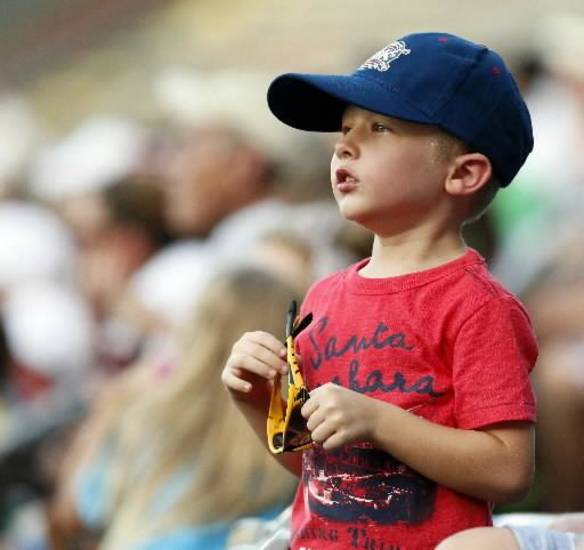 Brandon Chaney, 5, watches the Oklahoma City RedHawks play the Reno Aces at the Chickasaw Bricktown Ballpark in Oklahoma City, Friday, Aug. 2, 2013. This was Chaney's first baseball game. Photo by Nate Billings, The Oklahoman