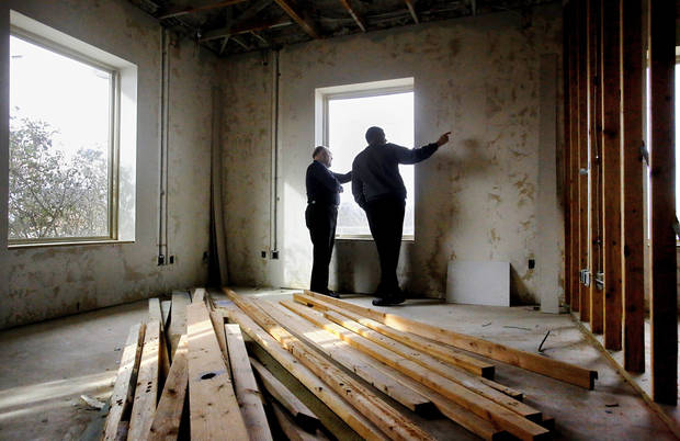 Ross VandeHamm, left, and Kevin Carr look through the windows in what will be Carr's new office at 1273 N Broadway in Edmond. The building will house the city of Edmond's information technology department. PHOTO BY JIM BECKEL, THE OKLAHOMAN. <strong>Jim Beckel - THE OKLAHOMAN</strong>
