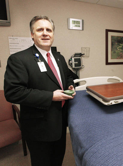 Deacon Paul Lewis, director of pastoral services at Mercy Hospital, holding a bowl of ashes in a hospital room at Mercy Hospital in Oklahoma City Monday, Feb. 11, 2013. Photo by Paul B. Southerland, The Oklahoman