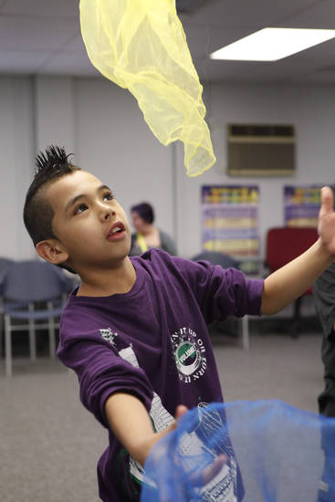 Pablo Espinoza, 9, practices  his scarf  juggle during a juggling class at the Capital Hill Library, Wednesday, March 14, 2012.  Photo By David McDaniel/The Oklahomen