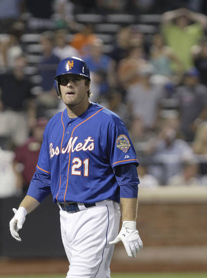 New York Mets' Lucas Duda walks away after hitting into a double play to end a baseball game against the Chicago Cubs on Friday, July 6, 2012, in New York. The Cubs won 8-7. (AP Photo/Frank Franklin II)