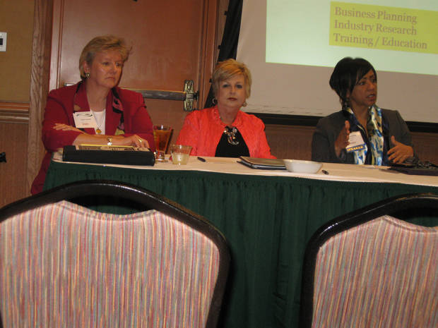 From left, Nancy Jackson of the Oklahoma Small Business Development Center, Barbara Rackley of Rural Enterprises Inc. and Sharron Jackson of Metro Technology Centers discuss resources -- including free counseling and market analysis, low-cost  training and financing -- available to women entrepreneurs. PHOTO BY PAULA BURKES <strong></strong>