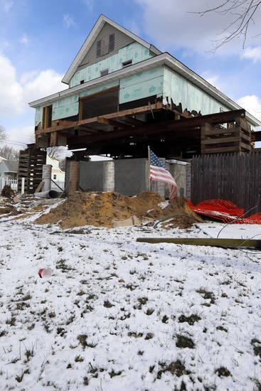 Snow covers the yard of a damaged home raised on stilts, Wednesday, Jan. 23, 2013, in Union Beach, N.J. Cold weather is bringing extra worries to residents of the areas hit by Superstorm Sandy. The deep freeze will continue into Thursday and Friday. There's a chance of snow Friday afternoon and evening, but accumulations are expected to be minor. (AP Photo/Julio Cortez)