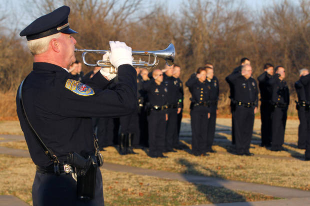 Edmond police Sgt. Bob Pratt plays the trumpet as the Edmond Police Department starts its new police academy with ceremonies at the police training center. PHOTOS BY PAUL HELLSTERN, THE OKLAHOMAN