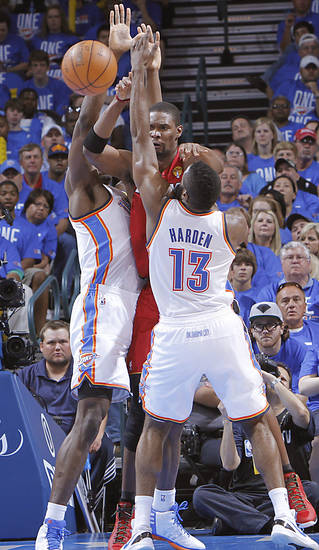 Oklahoma City's Serge Ibaka (9) and Oklahoma City's James Harden (13) defend on Miami's Chris Bosh (1) during Game 1 of the NBA Finals between the Oklahoma City Thunder and the Miami Heat at Chesapeake Energy Arena in Oklahoma City, Tuesday, June 12, 2012. Photo by Chris Landsberger, The Oklahoman