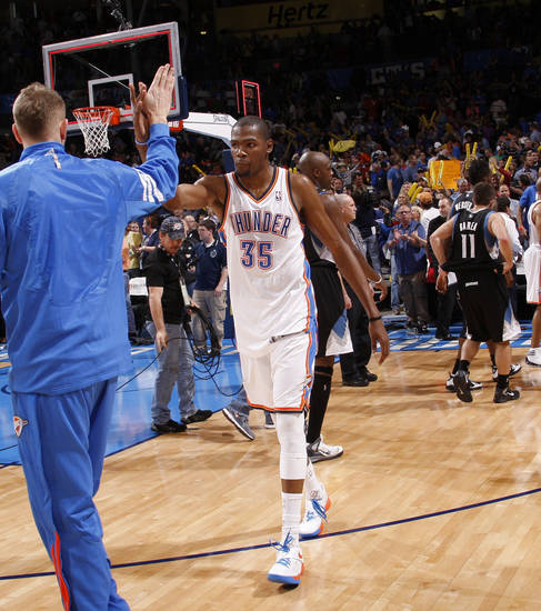 Oklahoma City's Kevin Durant (35) celebrates with Oklahoma City's Cole Aldrich after an NBA basketball game between the Oklahoma City Thunder and the Minnesota Timberwolves at Chesapeake Energy Arena in Oklahoma City, Friday, March 23, 2012. Photo by Bryan Terry, The Oklahoman