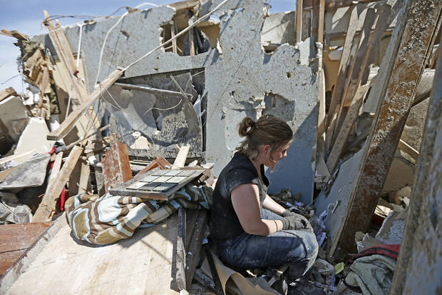 Sarah Patteson sits by the spot where she and her two children took shelter as the tornado hit her house on Kings Manor in Moore, Okla., Wednesday, May 22, 2013. A tornado damage the area on Monday, May 20, 2013. Photo by Bryan Terry, The Oklahoman
