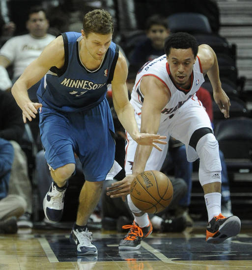 Minnesota Timberwolves point guard Luke Ridnour (13), left,  and Atlanta Hawks guard John Jenkins (12) race for the ball during the first half on an NBA basketball game in Atlanta, Monday, Jan. 21, 2013. (AP Photo/John Amis)