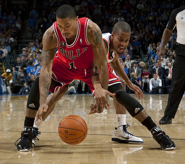 Oklahoma City's Eric Maynor defends Chicago's Derrick Rose during the NBA basketball game between the Oklahoma City Thunder and the Chicago Bulls in the Oklahoma City Arena on Wednesday, Oct. 27, 2010. Photo by Bryan Terry, The Oklahoman