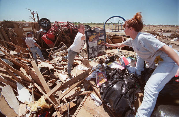 MAY 3, 1999 TORNADO: Tornado damage: Friends of Mark and Brenda Meadors remove items from their destroyed home Wednesday morning.  Mark is a coach of the Del City Eagles, a little league baseball team, and parents of team members arrived at the Meadors home Wednesday to assist in salvaging personal items.