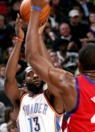 Oklahoma City's James Harden puts up a shot in front of Philadelphia's defense during the second half of their NBA basketball game at the Ford Center in Oklahoma City on Tuesday, Dec. 2, 2009. The Thunder beat the 76ers 117 to 106. By John Clanton, The Oklahoman