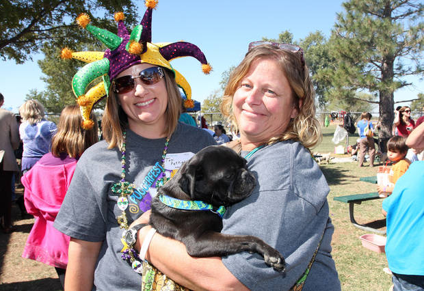 Tony Pettigrew and Anita Brenberger holding Keisha at the Pupperfest 2011 Mardi Gras Madness.
