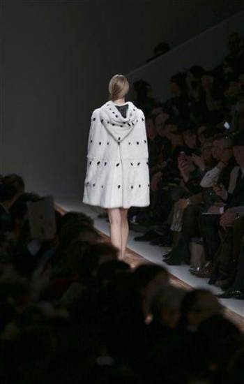 A model wears a creation by fashion designers Maria Grazia Chiuri and Pier Paolo Piccioli for Valentino's Ready to Wear's Fall-Winter 2013-2014 fashion collection, presented, Tuesday, March 5, 2013 in Paris. (AP Photo/Thibault Camus)