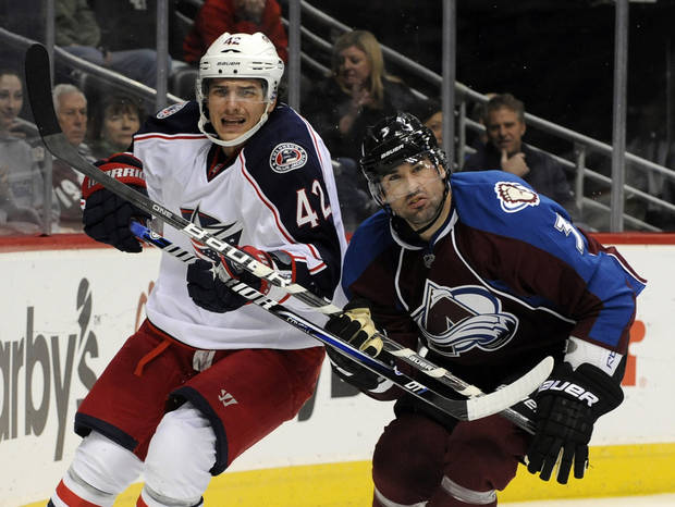 Columbus Blue Jackets center Artem Anisimov (42), from Russia, and Colorado Avalanche defenseman Ryan O'Byrne (3) look on during the second period of an NHL hockey game on Thursday, Jan. 24, 2013, in Denver. (AP Photo/Jack Dempsey)