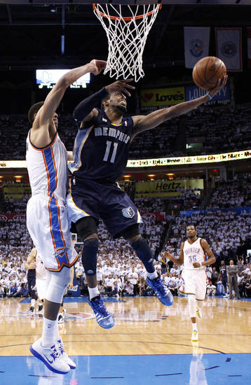 Memphis' Mike Conley (11) shoots a lay up as Oklahoma City's Thabo Sefolosha (2) defends during Game 5 in the second round of the NBA playoffs between the Oklahoma City Thunder and the Memphis Grizzlies at Chesapeake Energy Arena in Oklahoma City, Wednesday, May 15, 2013. Photo by Sarah Phipps, The Oklahoman