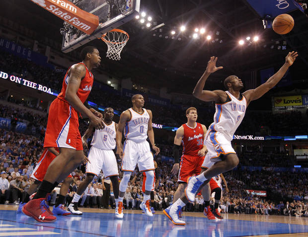 Oklahoma City Thunder power forward Serge Ibaka (9) goes after a loose ball during the NBA basketball game between the Oklahoma City Thunder and the Los Angeles Clippers at Chesapeake Energy Arena on Wednesday, March 21, 2012 in Oklahoma City, Okla.  Photo by Chris Landsberger, The Oklahoman