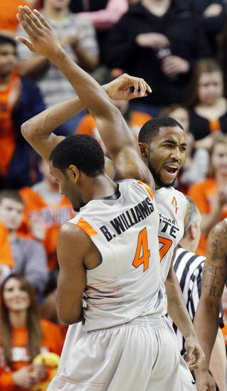OSU's Michael Cobbins (20) and Brian Williams (4) celebrate in the first half of the Bedlam men's college basketball game between the Oklahoma State University Cowboys and the University of Oklahoma Sooners at Gallagher-Iba Arena in Stillwater, Okla., Monday, Jan. 9, 2012. Photo by Nate Billings, The Oklahoman